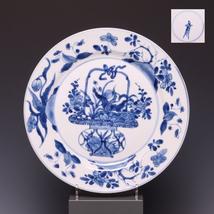 A bluewhite porcelain plate decorations of a basket with handle a bluewhite porcelain plate decorations of a basket with handle carrying flowers mightylinksfo