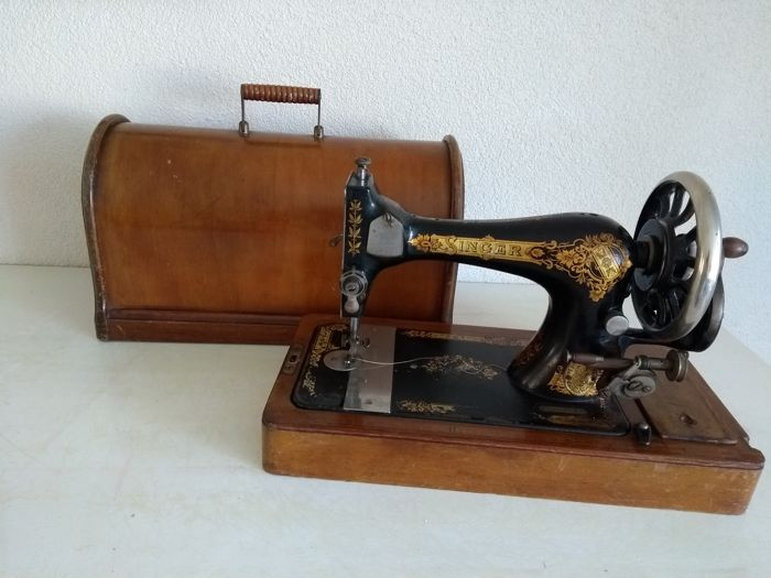 Singer sewing machine with wooden dust cover, 1899