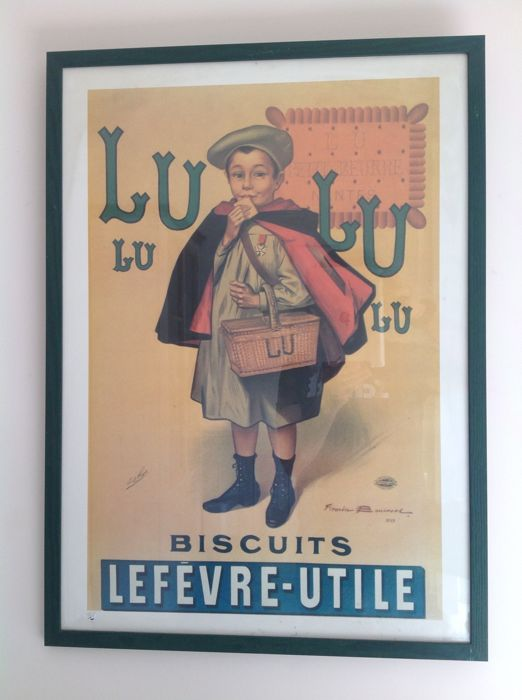 Antique advertising poster in frame