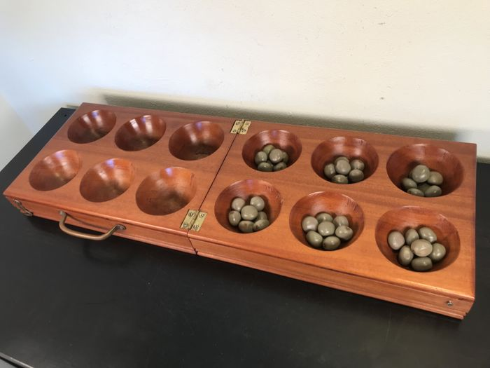 Very large African Oware game, made of wood and bonduc seeds
