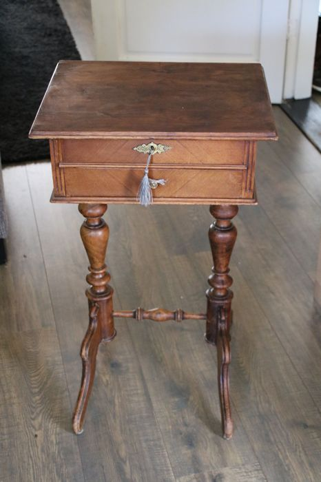 A walnut sewing table, early 20th century