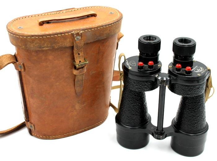 This is a B. H.& G Ltd 1943 Binocular Prismatic No5 Case Mk1 in the original leather case - preserved
