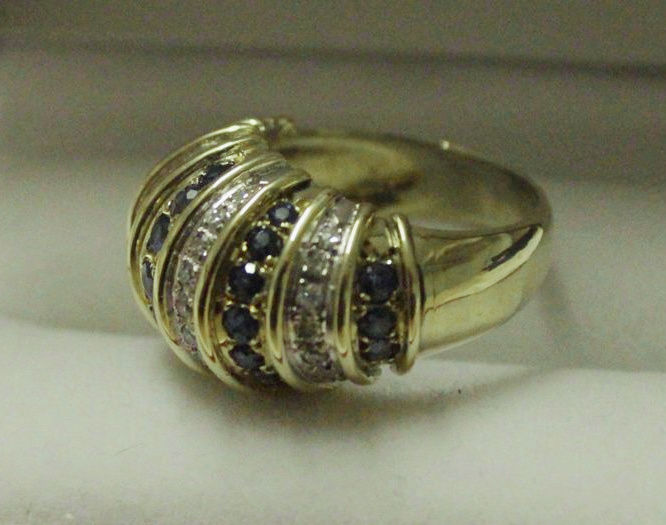 14 kt yellow-gold ring inlaid with diamonds and sapphires