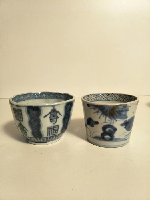 Two blue and white Arita porcelain mugs decorated with calligraphy and flowers - Japan - 19th century
