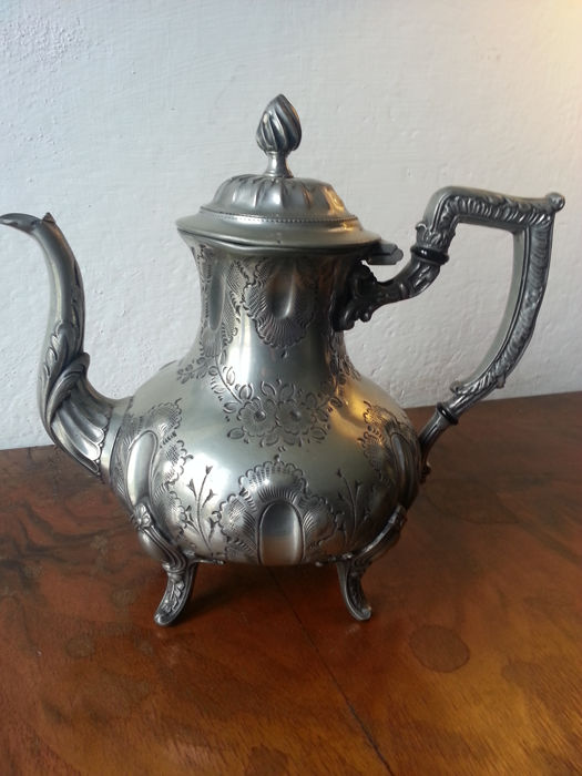 Chiselled pewter teapot