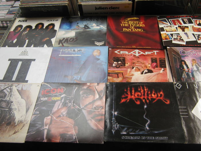 Very Nice hard-rock lot off 12 lp's like: Tygers Pan tang,Komander of kaos,Cinderella,Malice,Helion,Axxis,Kraft,Kiss,Hurricana,Blackfoot,Icon