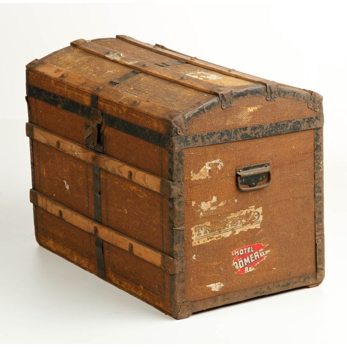 Wooden travel chest lined with linen and metal frames on the corners ...