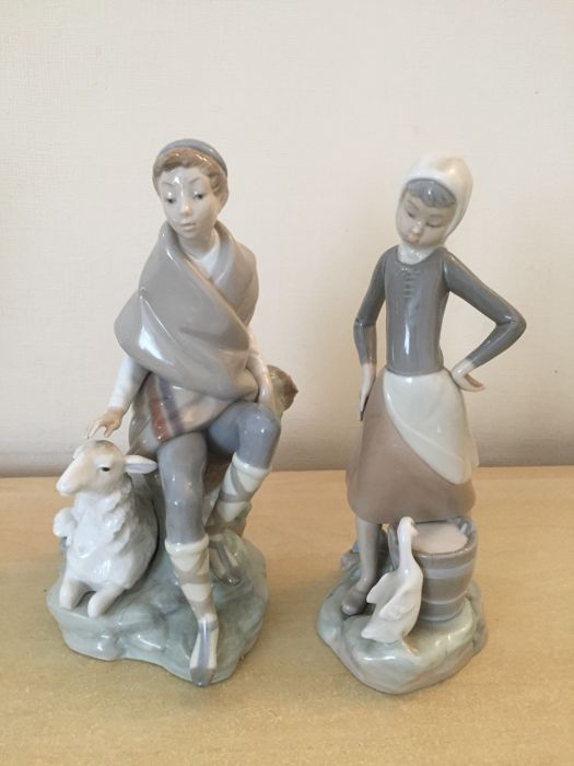 2 Lladro figurines - boy and girl with animals