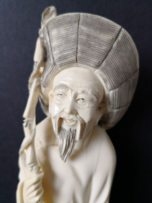 Ivory statue of a fisherman - China - approx. 1930
