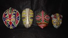 Zaire - 4 tribal masks - all signed by artists