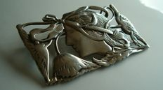 Large silver Art Nouveau brooch, lady in profile, surrounded by poppies.