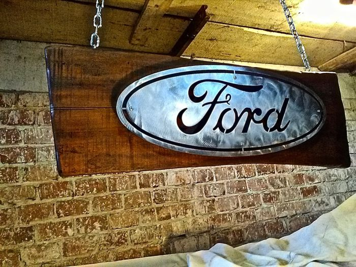 Ford metal sign on a large sized solid walnut panel