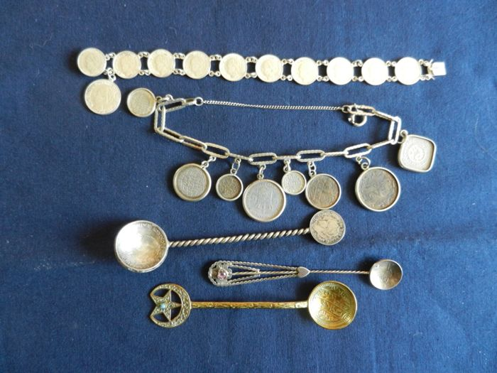 Lot of coin memorabilia consisting of: 3 so called coin spoons and two coin bracelets: twentieth century