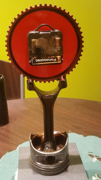 Coustom clock in PORSCHE inspiration. Composed of original German parts. ca 35 cm tall.