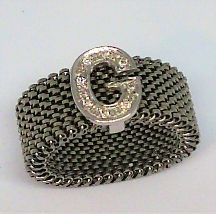 Elastic ring by Pascià in steel with 750 white gold letter G and diamonds
