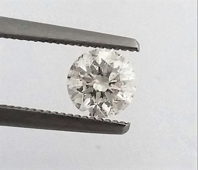 Round Brilliant Cut  - 0.75 carat  - E color  - SI1 clarity  - Natural Diamond  Comes With AIG Certificate + Laser Inscription On Girdle