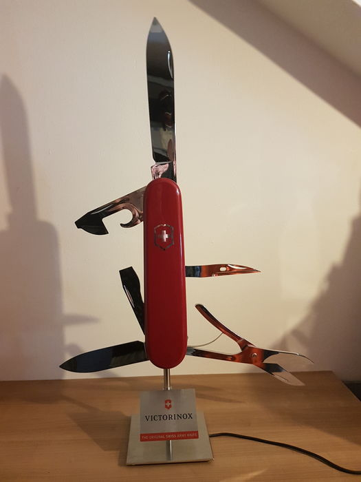 Victorinox Swiss army knife electronic store display with five moving blades