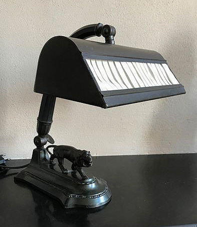 A metal adjustable desk lamp with lion on the foot, circa 1920
