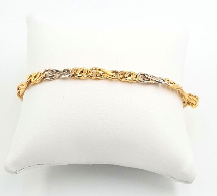 "18 kt white and yellow gold ""MANCINI"" bracelet, weight: 7.93 g, length: 21 cm"