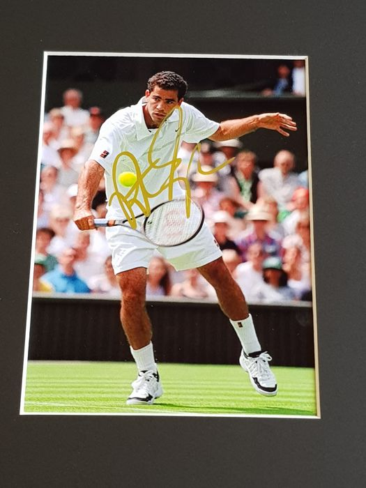 Pete Sampras - Tennis Legend - Typical pose from the former World number 1 - hand signed framed photo + COA.