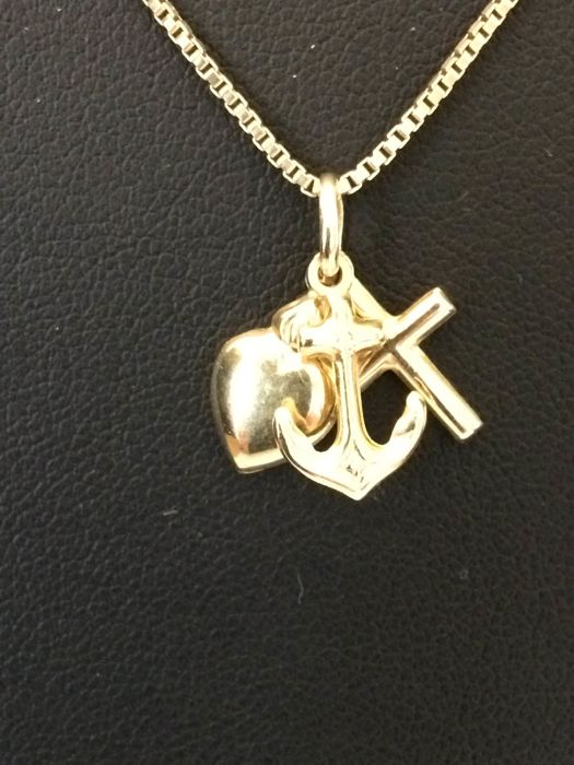 Gold necklace with gold pendant; faith, hope and love