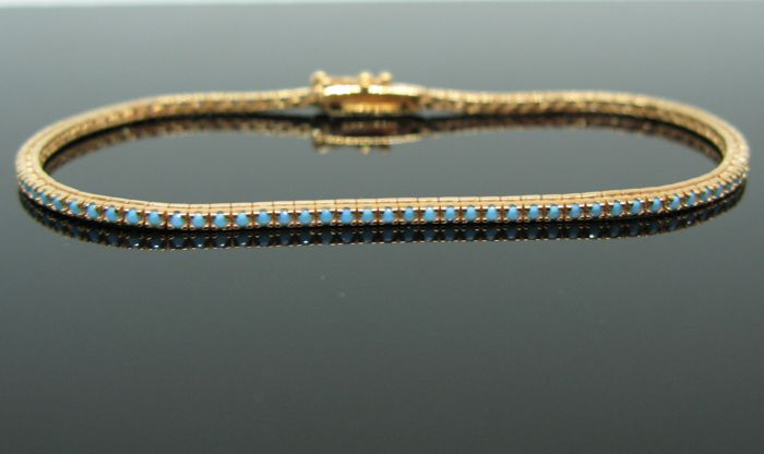 18 kt pink gold tennis bracelet set with natural turquoise round-cut ct 2,00 tot. Measurement 18 cm  Weight 7 gr.