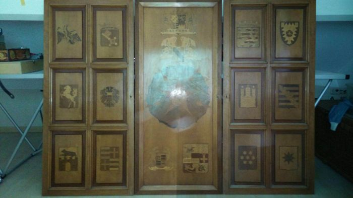 Three cabinet doors inlaid with heraldic coats of arms, 20th century