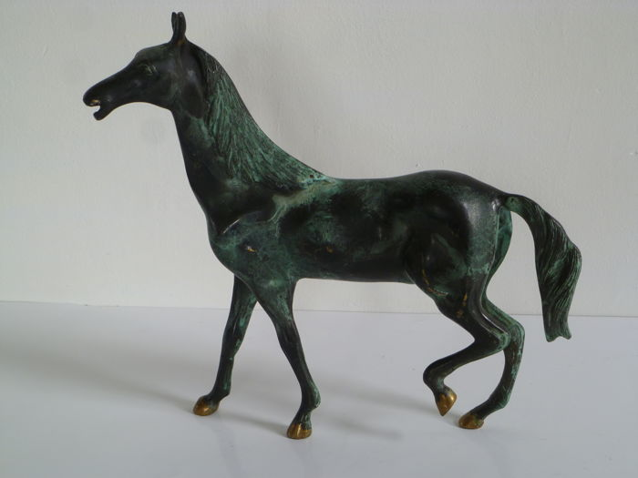 Bronze horse with green patina