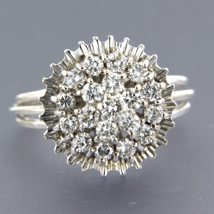14 kt white gold entourage ring set with 19 brilliant cut diamonds, approximately 1.00 carat in total, ring size 18.25 (57)