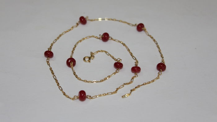 Ladies necklace gold 18 kt with nine rubies of 6 x 4 mm