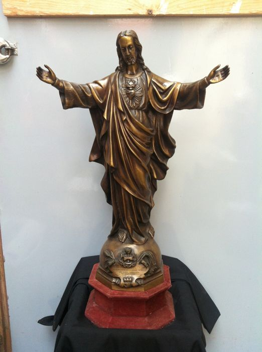 Unique bronze Sacred Heart statue of Jesus Christ on wooden pedestal with monogram