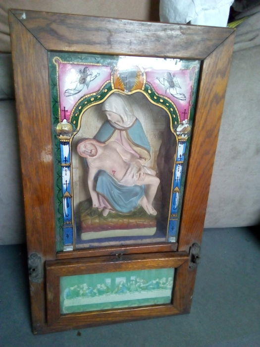 Built in figure in Prayer shelf or frame with figure of Madonna and wounded Jesus.