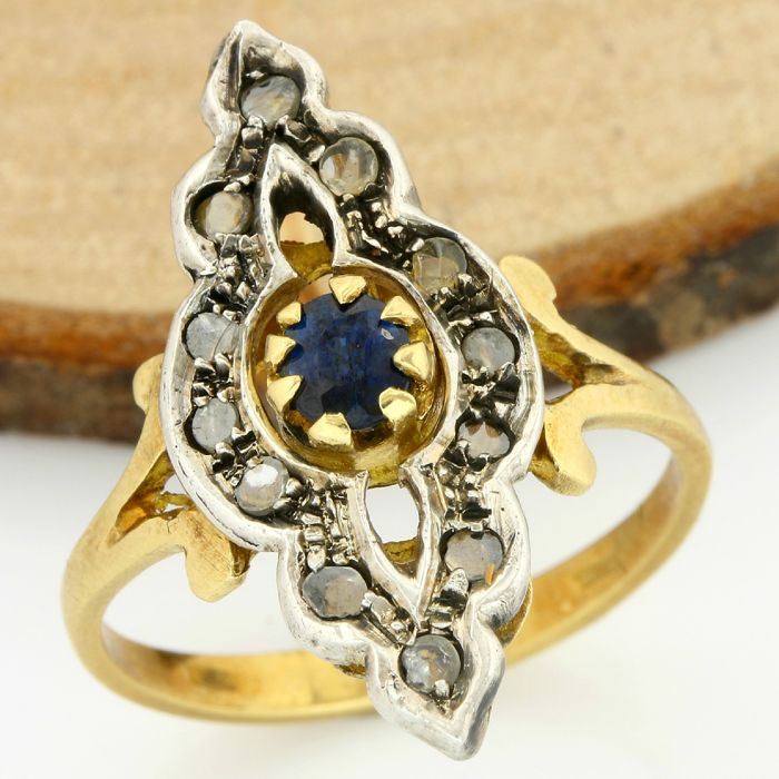 18kt/750 Yellow and White Gold - 0.45 ct Rose Cut Diamond, 0.20 ct Round Cut Sapphire; Ring Size: 7.25