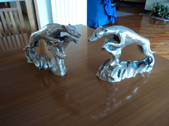 Pair of Ottaviani silver coated resin dogs