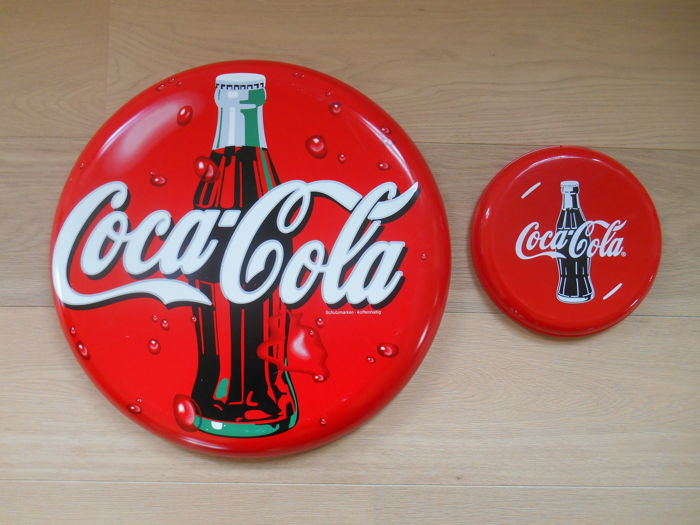 2 advertising signs for Coca-Cola from the 1990s