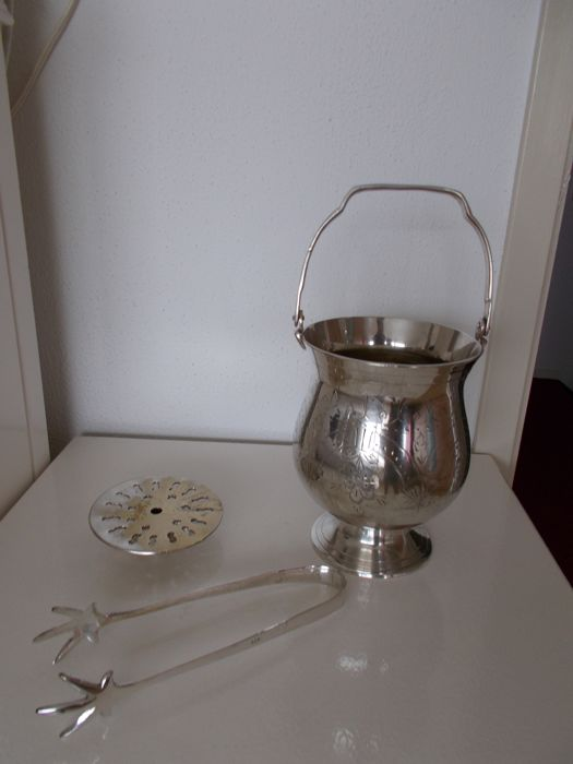 silver plated ice bucket with strainer and tongs - the rest is unknown to me