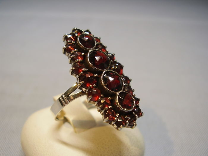 Big antique Victorian ring with blood red rose garnets on two levels of 7 ct in total.