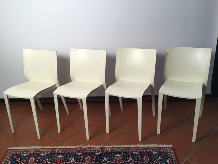 Philippe Starck in XO - 4 Slick-Slick chairs