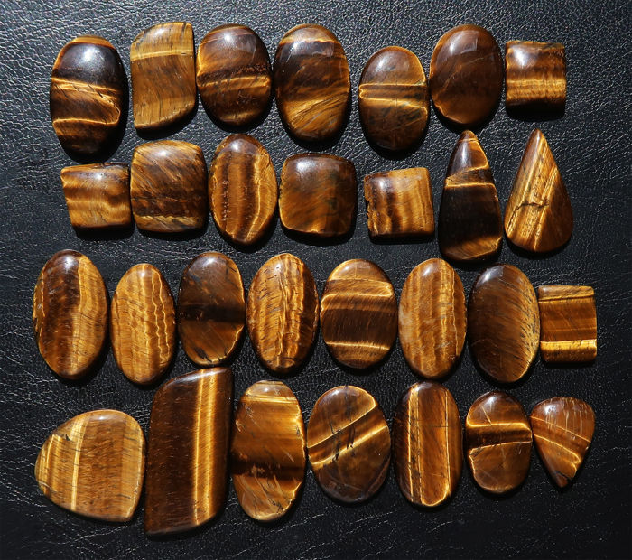 Impressive lot of large cabochons of natural Tiger's eye - 1.9 to 5 cm - 1005 ct (29)