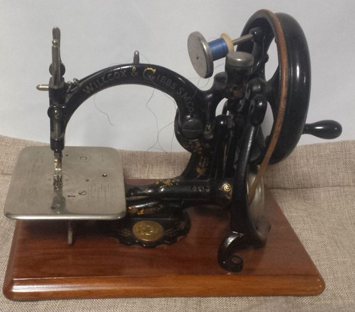 A Willcox & Gibbs sewing machine with original wooden case, ca.1880