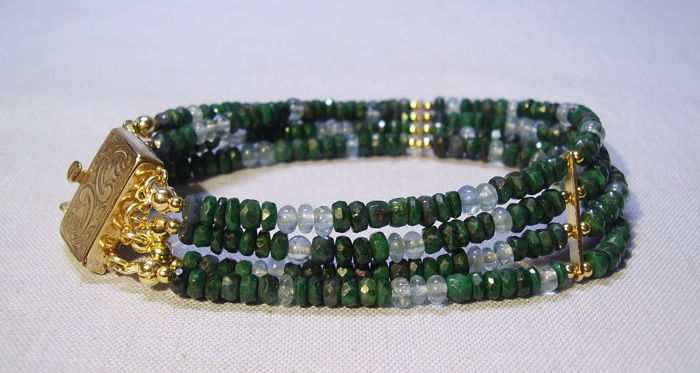 4-row bracelet made of faceted natural emerald rondelles of 85 ct and natural aquamarines 10 ct