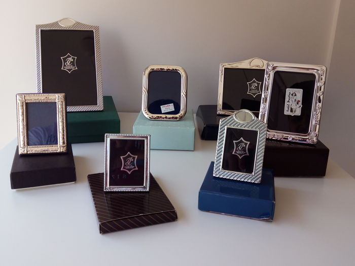 A collection of silver picture frames, in different shapes and sizes - Spain and Italy - second half of the 20th century