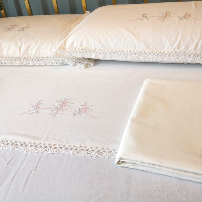 Two cotton double bed sheets and two pillowcases with lace edge  Never used