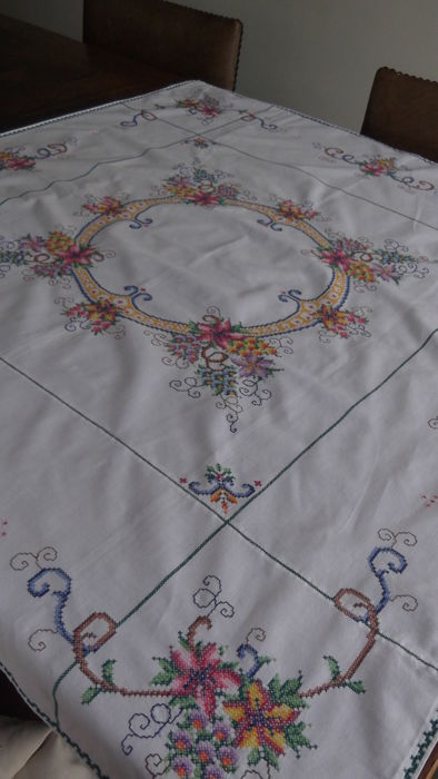Vintage hand embroidered tablecloth in cross stitch
