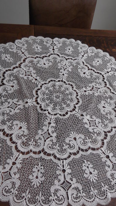 Very old and fine lace tablecloth - round
