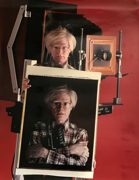 Bill Ray (1936-) - Andy Warhol holding self portriat