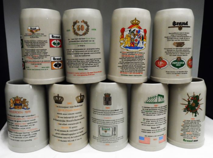 Collection of 9 large earthenware beer mugs - content 1 litre - special year issues of Brand beer