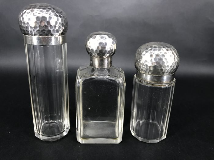 Set of small beauty bottles with silver caps