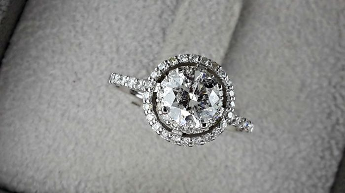 1.52  ct E/VS2 round diamond ring made of 14 kt gold