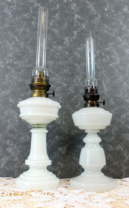 Two antique opaline glass oil lamps with original wind glass, early 1900, France